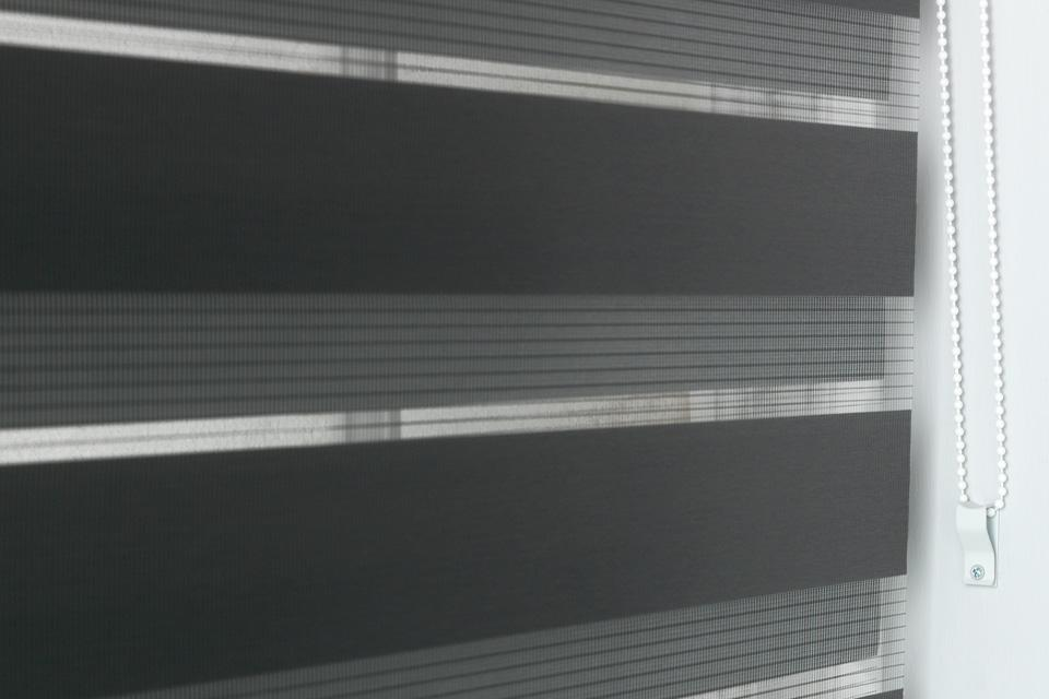 Day and night blinds in black.
