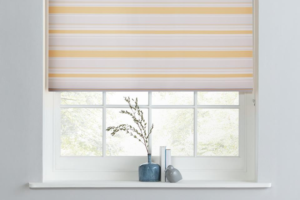 Yellow and white striped roller blinds.