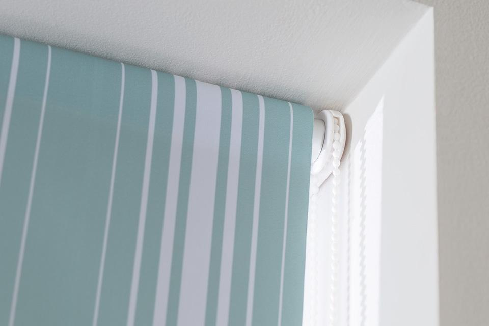 Striped turquoise roller blind.