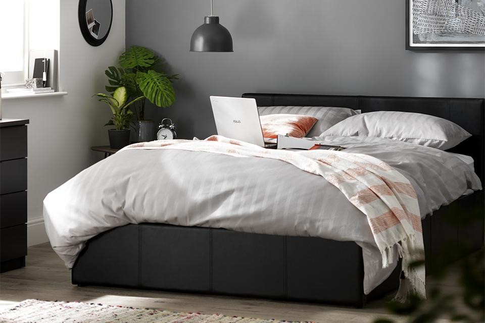 A leather upholstered bedframe.