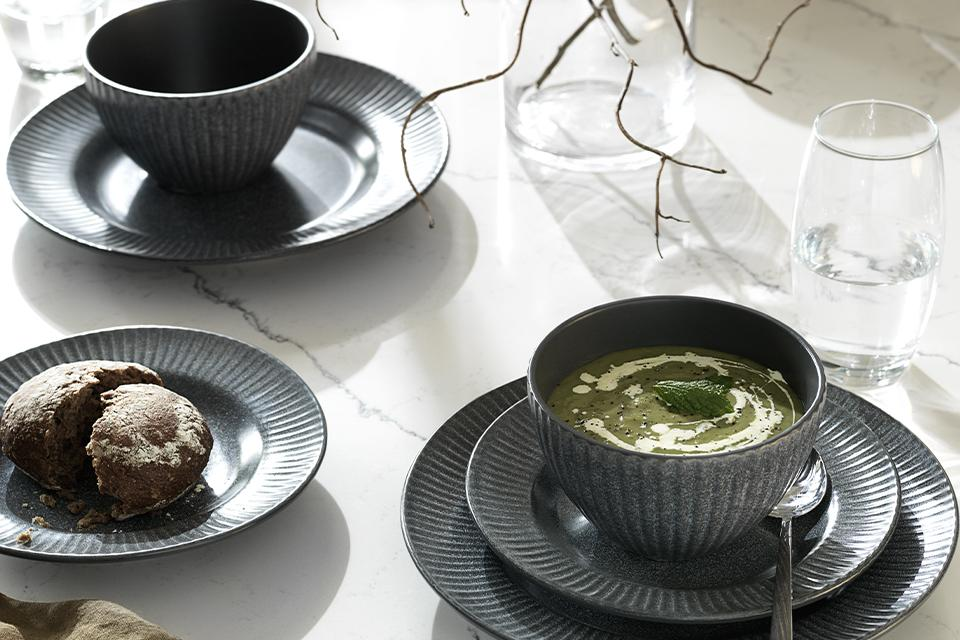 Soup and cake showcasing the black textured Argos Home Felicity dinner set.