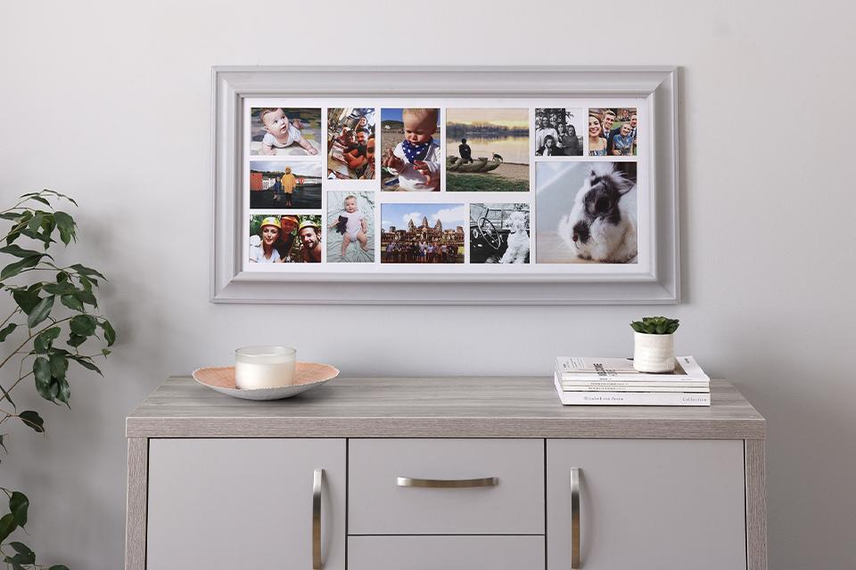 Image of a framed photo collage hanging above a sideboard.