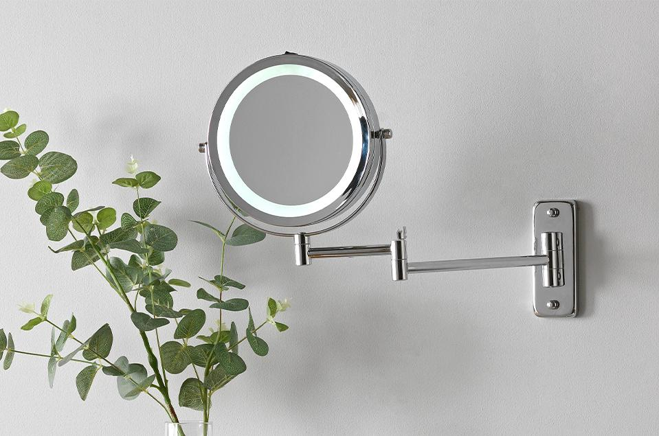Image of a round, extendable, light-up bathroom wall light.