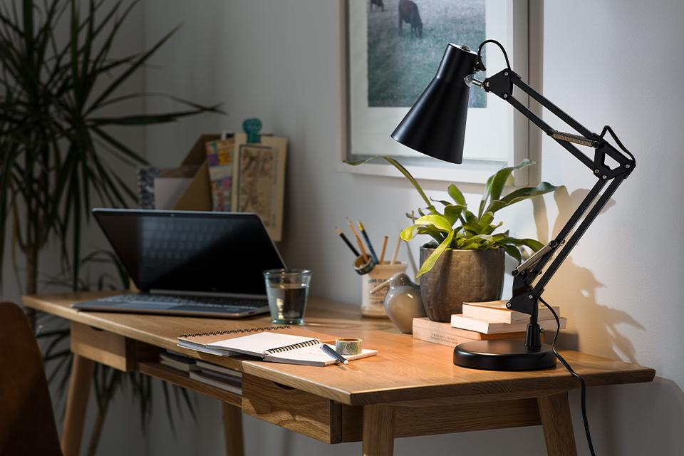 An image of a black desk lamp with an adjustable neck.