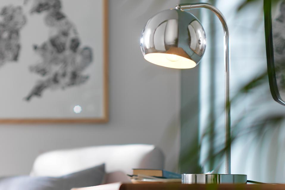 An image of a chrome arched table lamp.
