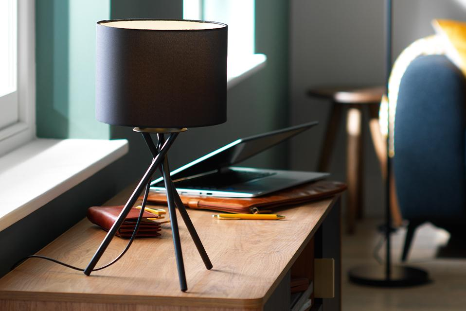An image of a black tripod table lamp.