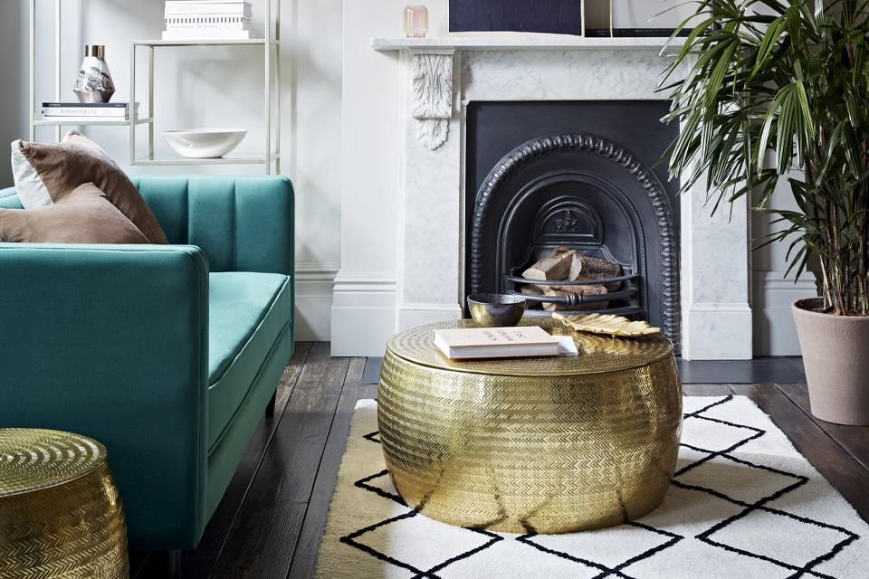 Image of a luxury living room with a brass table,