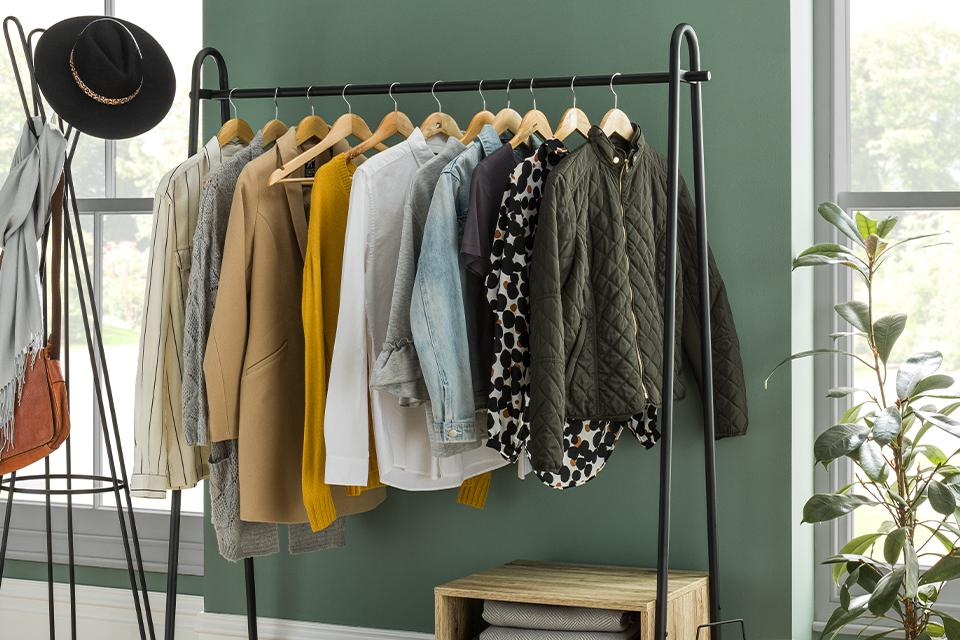 Image of a clothes rail and shoe storage unit in a bedroom.