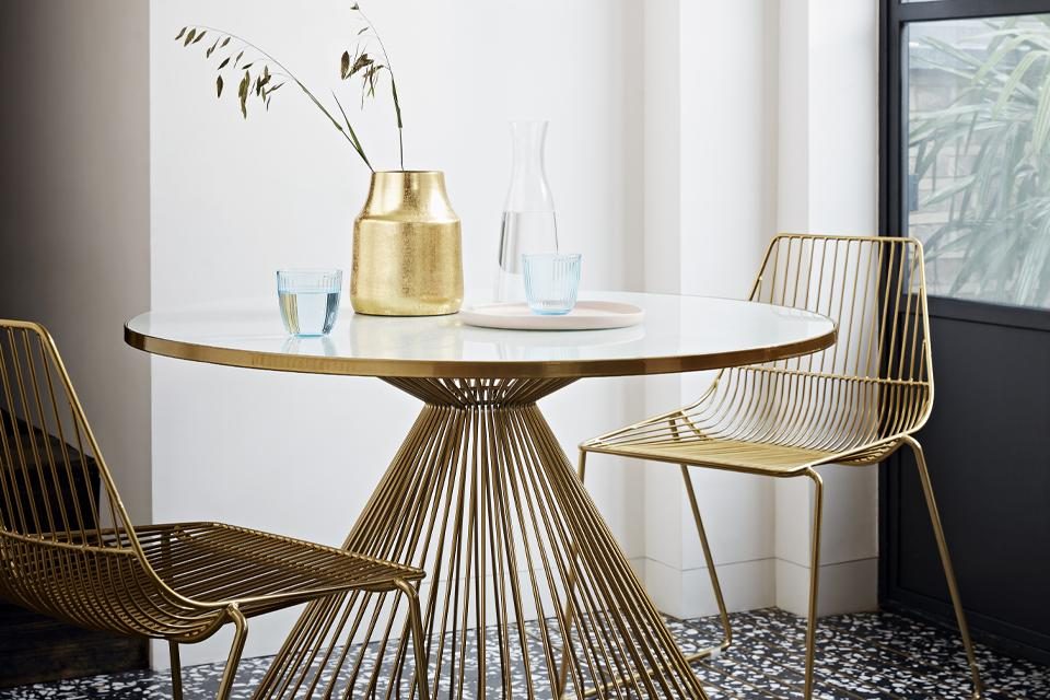 Image of a stylish gold dining set.