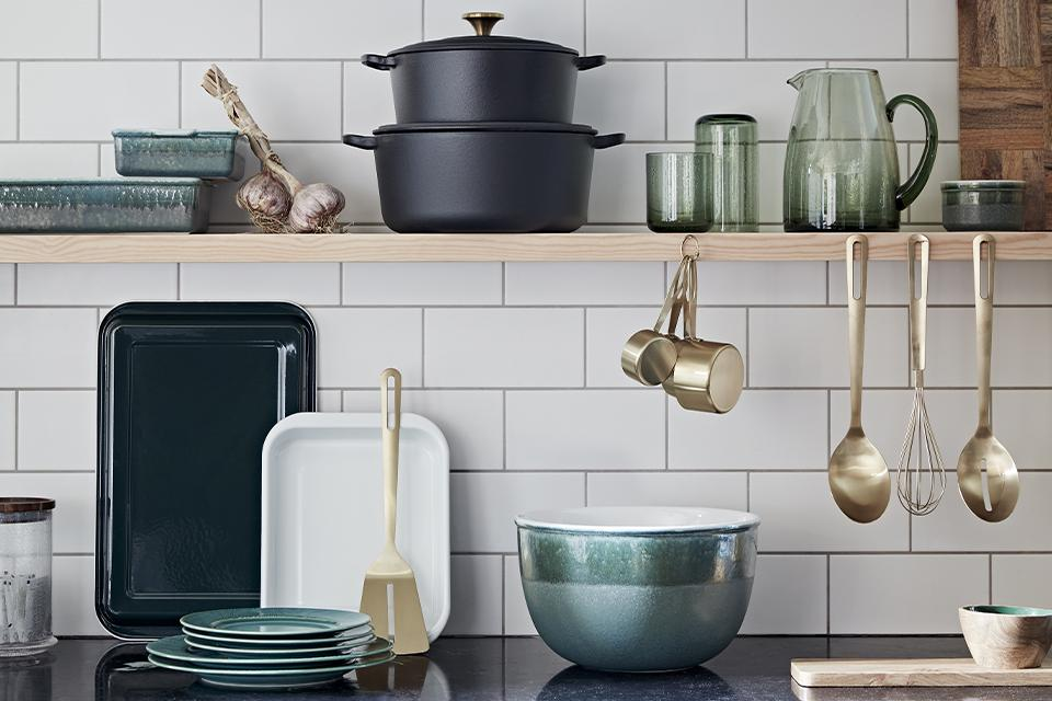 Image of a kitchen with various cookware on the counter.