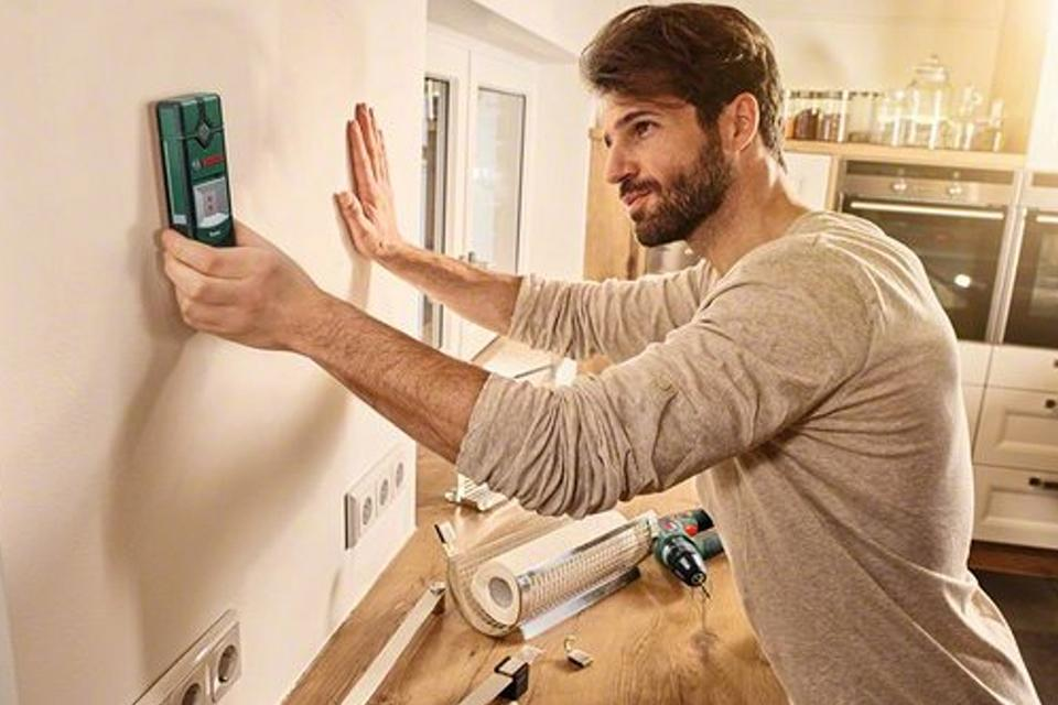 Image of a man checking the electrics.