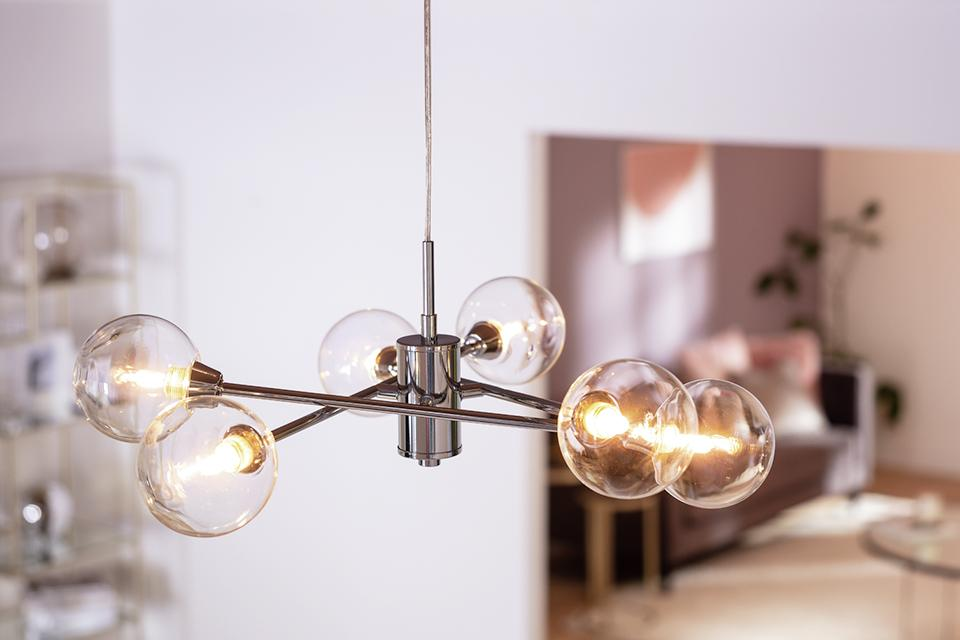 Image of a chrome pendant with six exposed bulbs.
