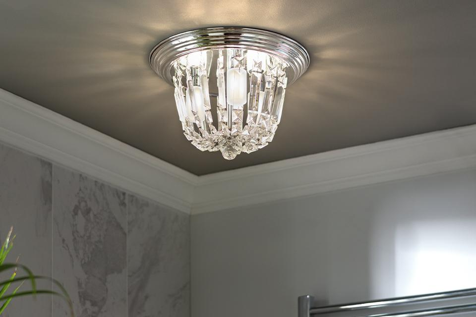 Image of a glass, flush bathroom ceiling light.