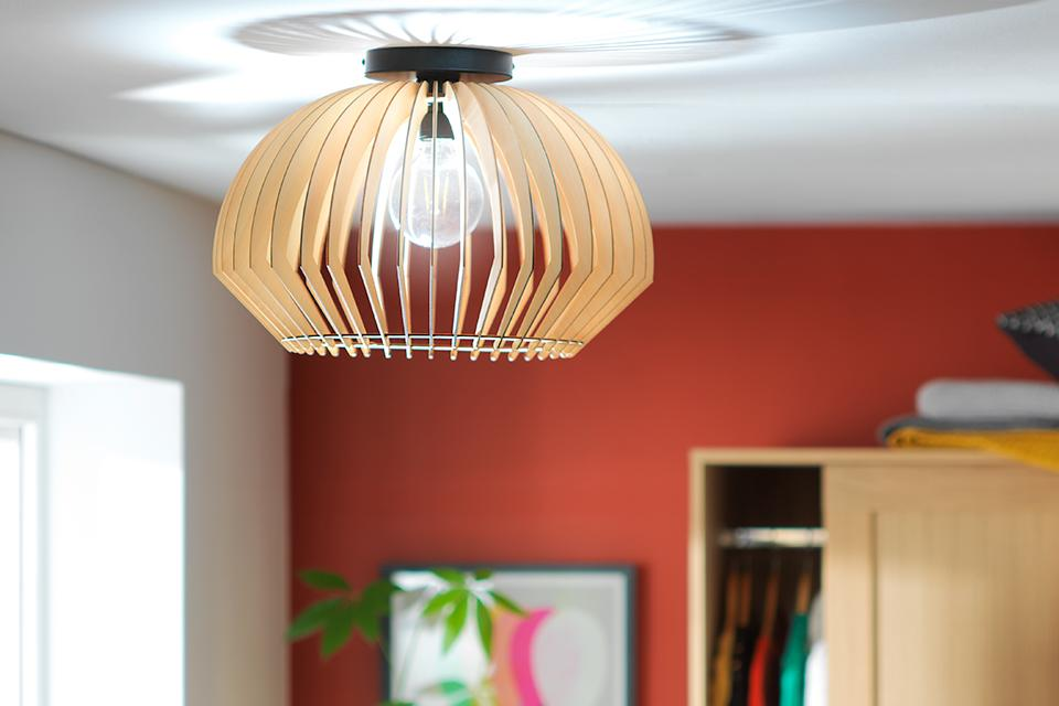 Image of a slatted wooden flush ceiling light.