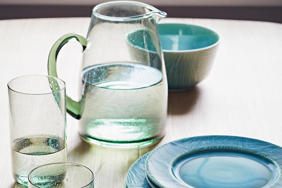 Green bubble glassware and blue-green plates and bowl.