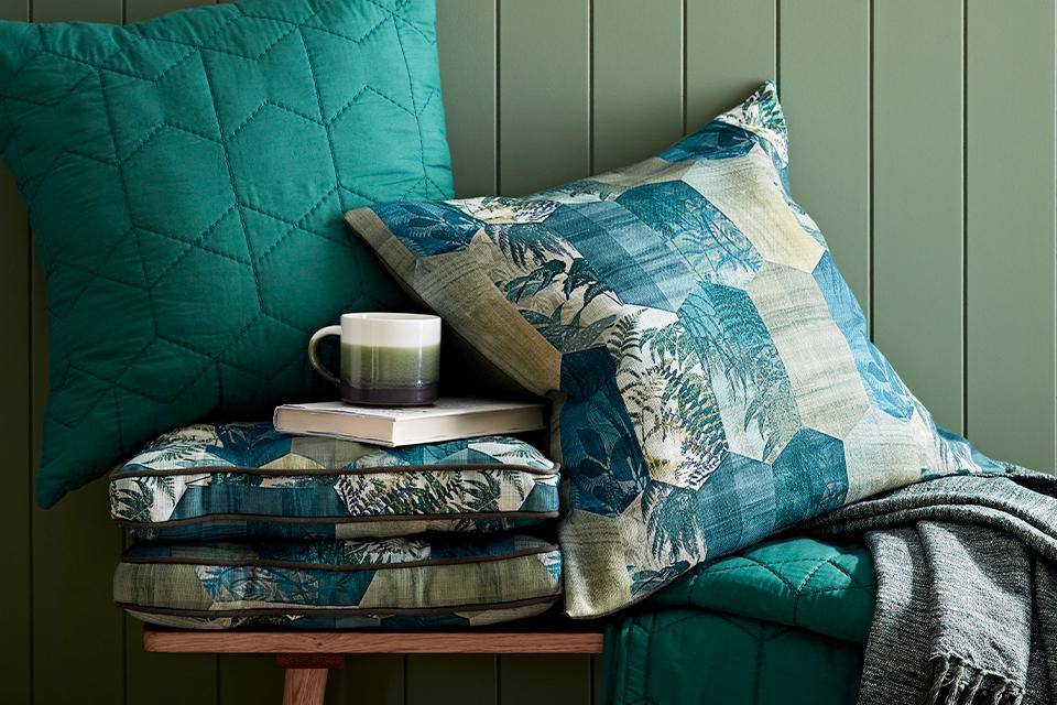 Green and botanical print cushions.