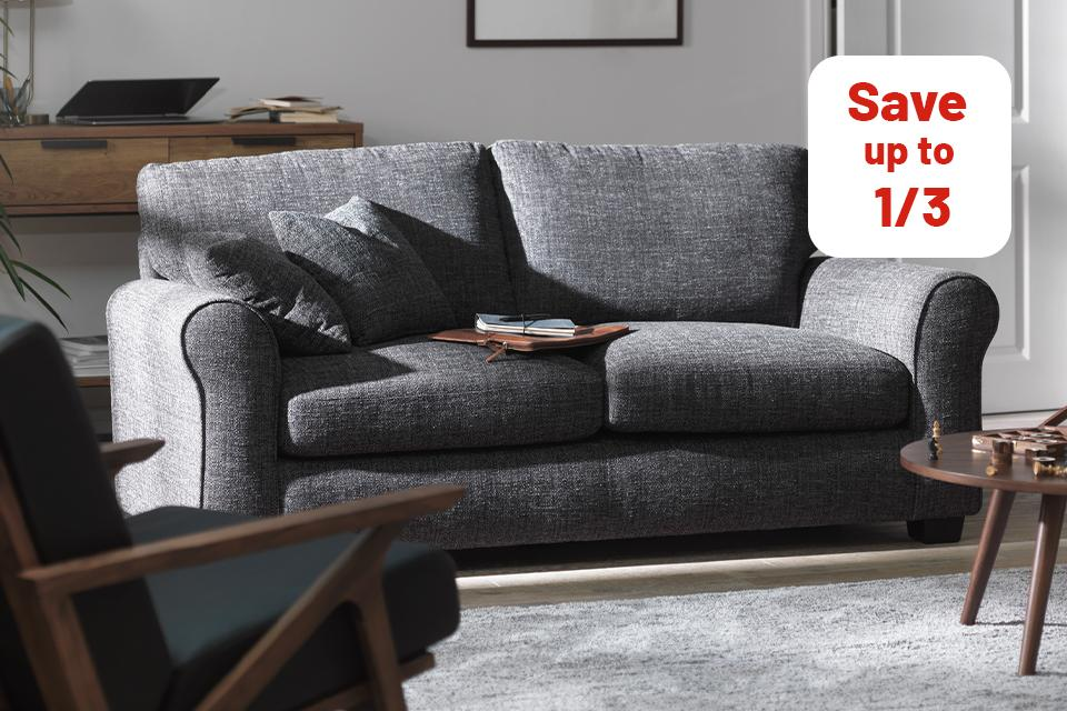 Image of grey sofa in white living room.
