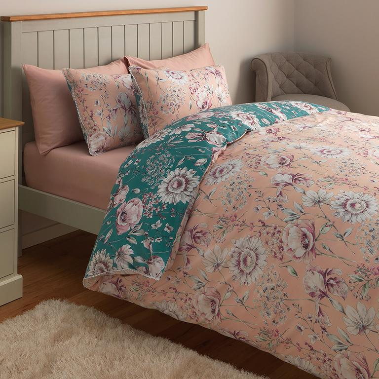 Image of pink and turquoise floral bedding.