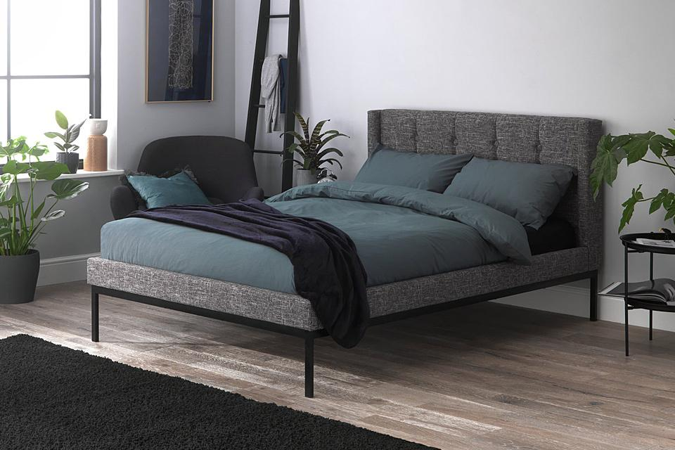 Habitat grey upholstered bed in a stylish bedroom.