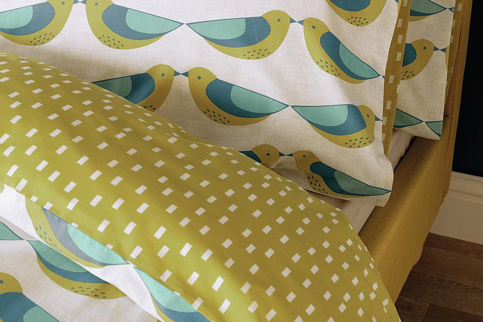 Pillow and close up of duvet set, with green birds.