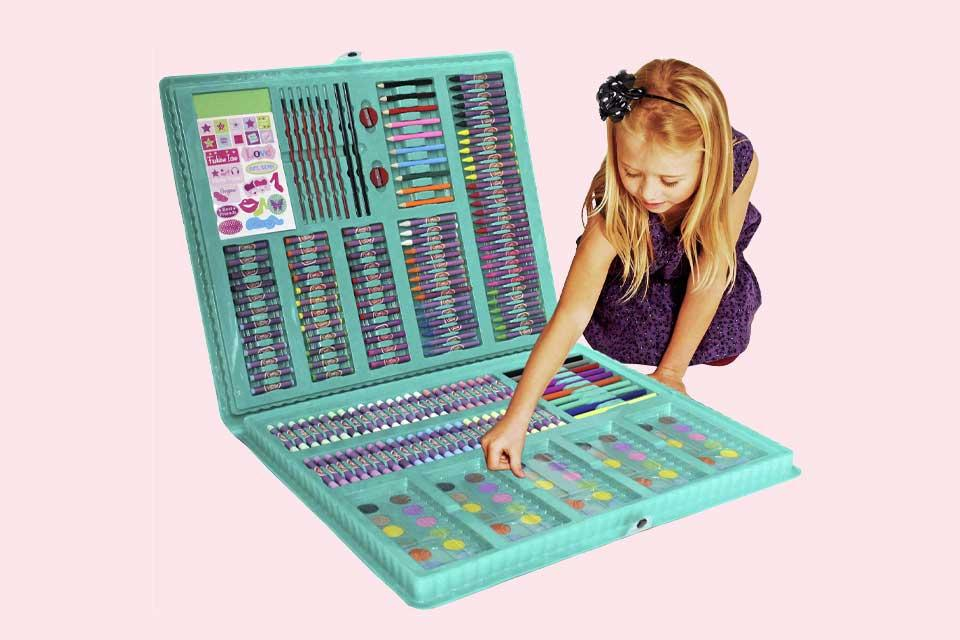 Image shows a small girl selecting a crayon from a huge art kit.