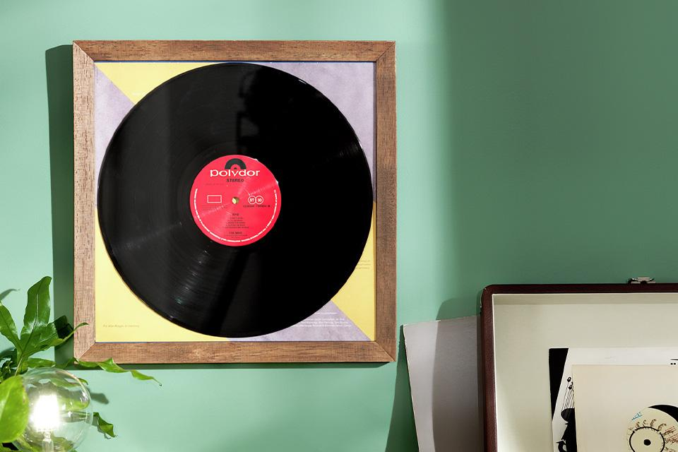 Framed record wall art above a turntable.
