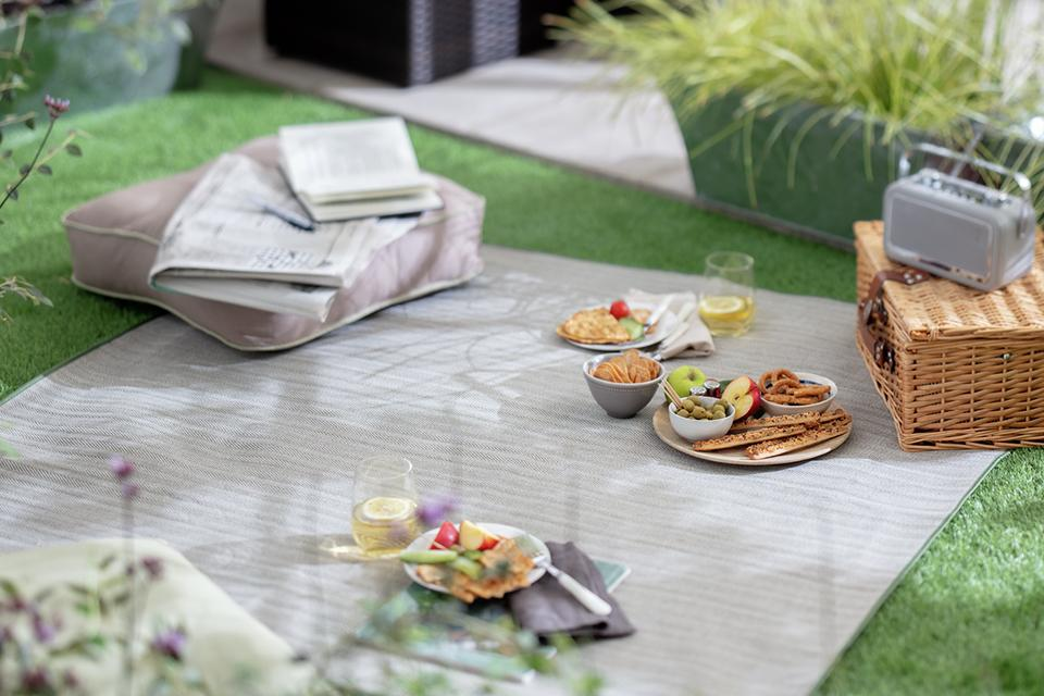 A grey picnic blanket.