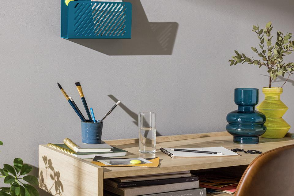 Image of a craft desk with a storage unit on the wall.