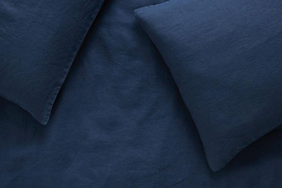 Image of navy linen bedding.