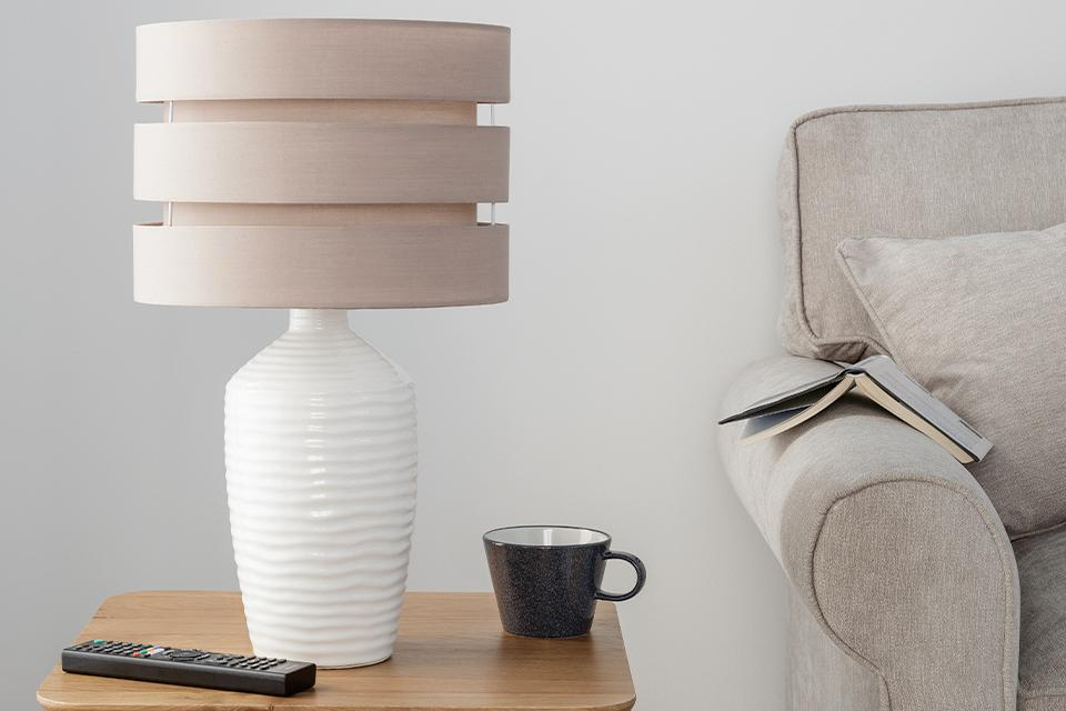 Image of white lamp on a coffee table.
