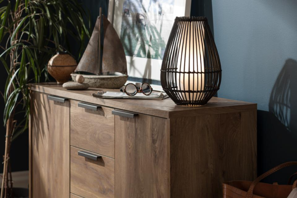 Image of a table lamp with a rattan shade.