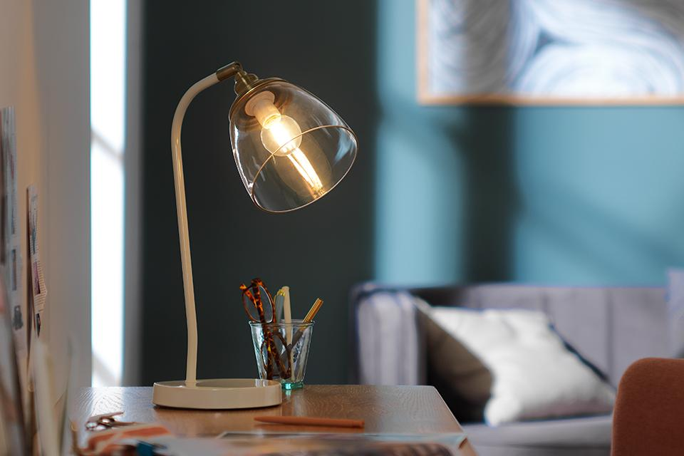 Image of a desk lamp with a glass shade.