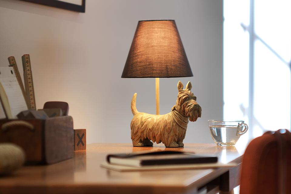 Image of a table lamp with a dog stand and a grey shade.