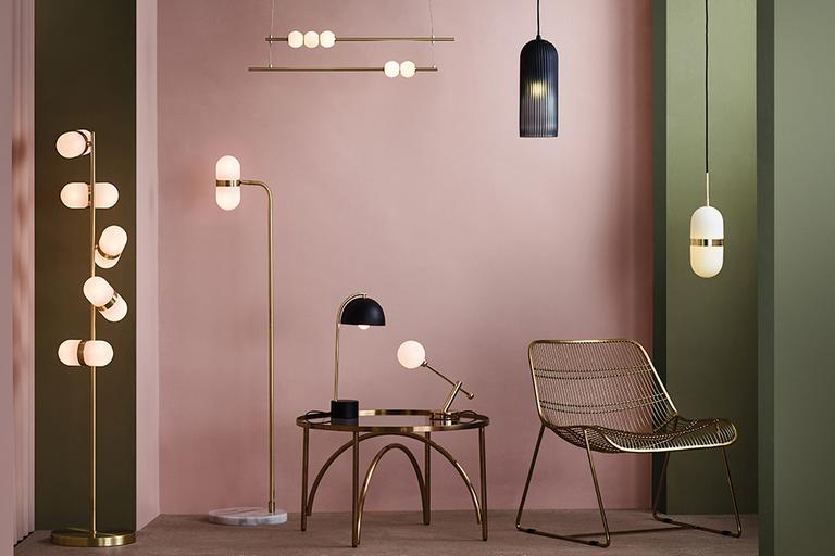 Image of various light types in black and gold in a pink room.