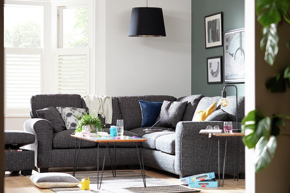 Image of grey corner sofa in living room.