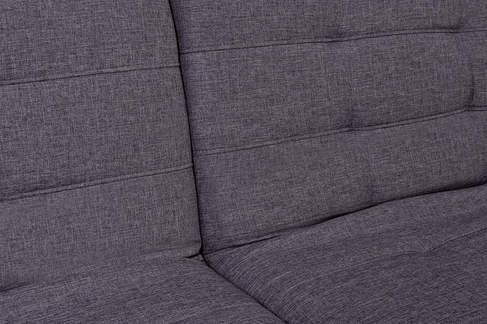 Close up image of grey upholstery fabric.