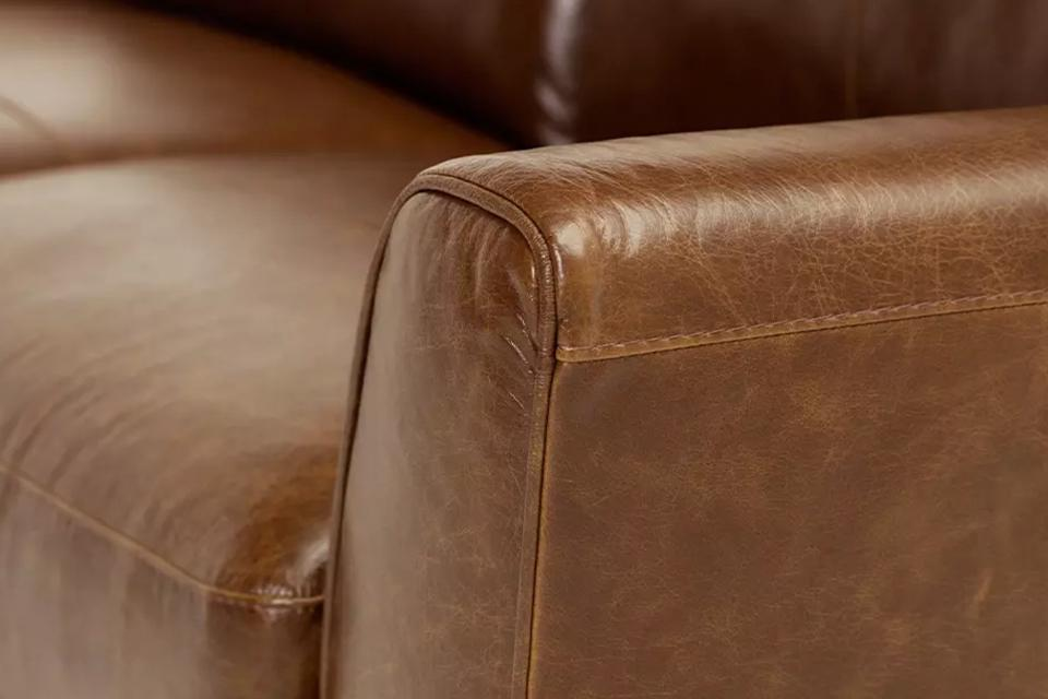 Image of the arm of a leather sofa.