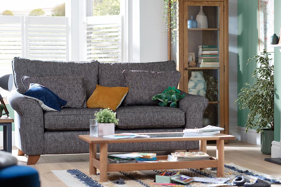 Image of grey fabric sofa next to coffee table.