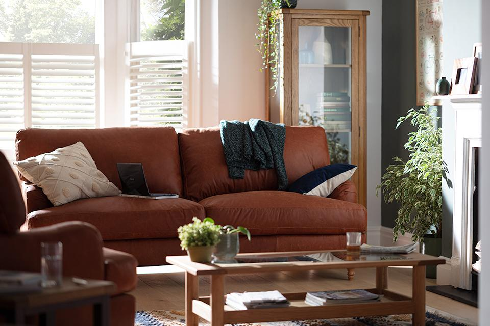 Image of 4 seater sofa in living room.