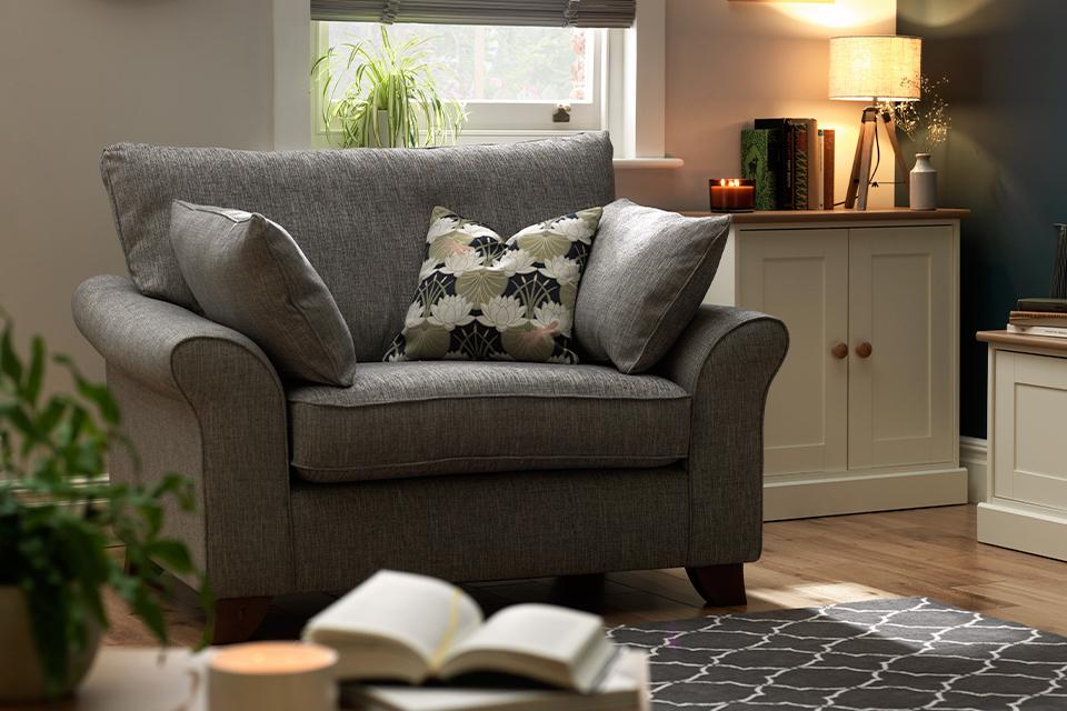Image of cuddle chair with cushions in living room.