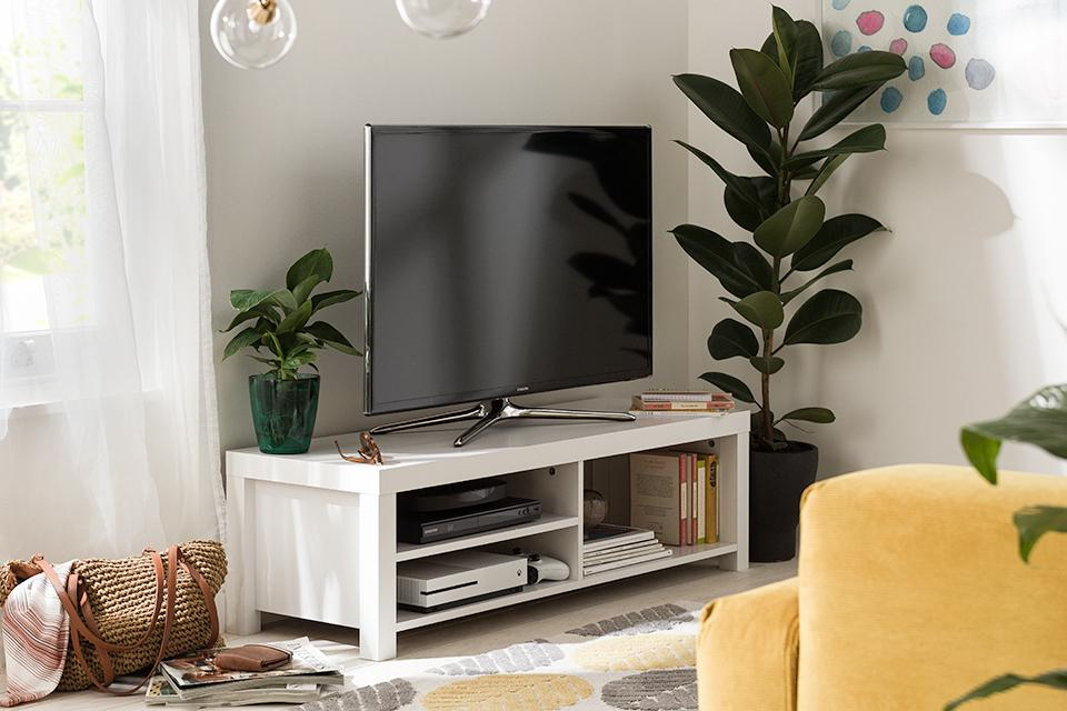 Image of a white TV stand in a white living room.