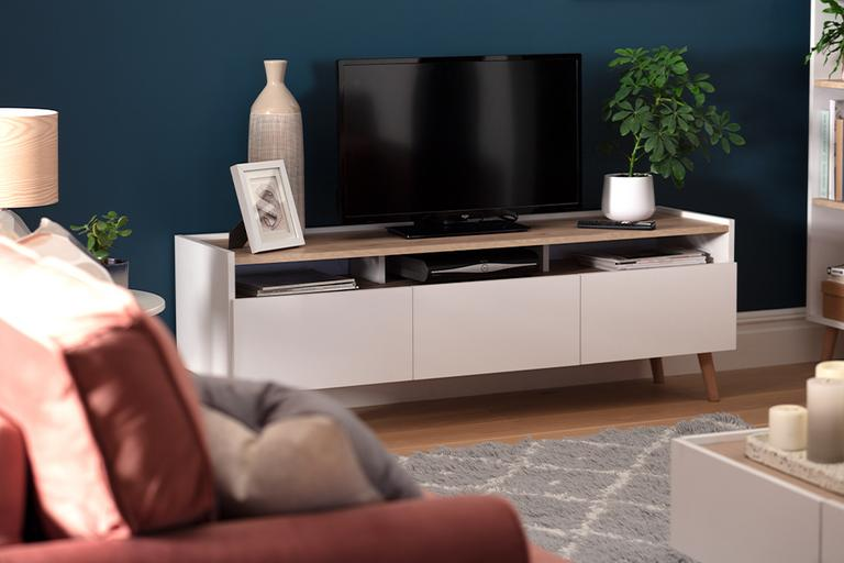 Image of white TV stand in a teal coloured living room.