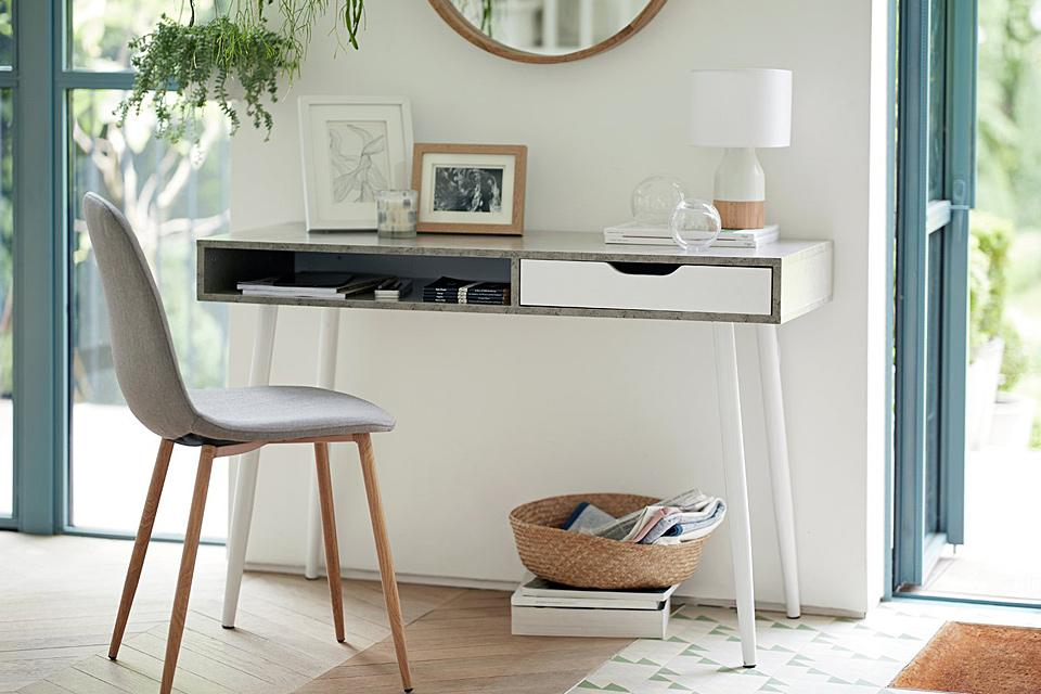 Concrete effect desk with drawer and white legs, with grey office chair.
