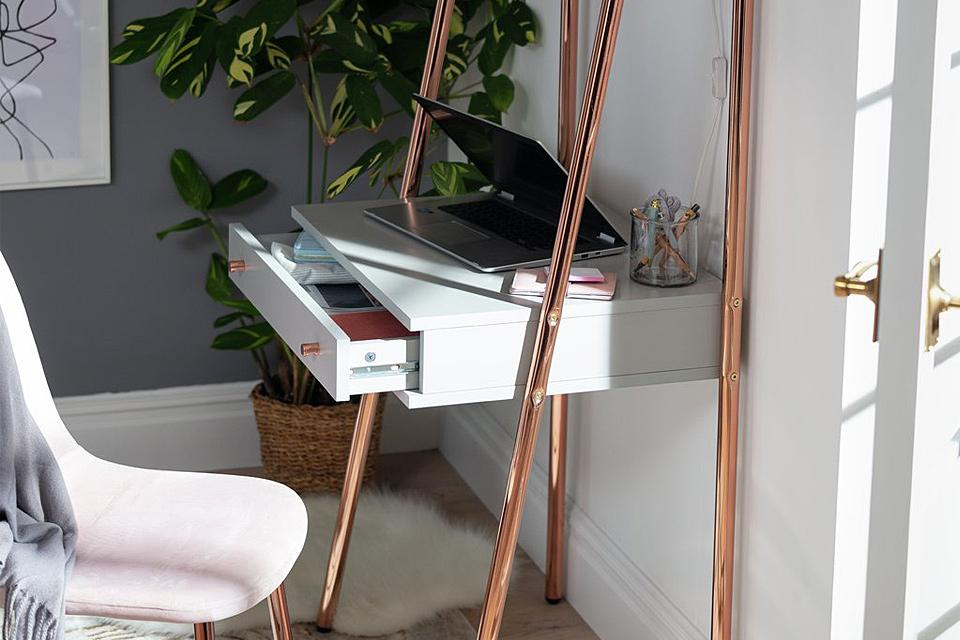 Ladder desk with grey shelves and rose gold legs.