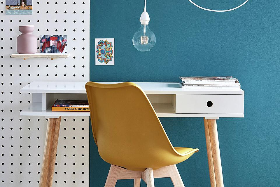 White desk with yellow office chair.