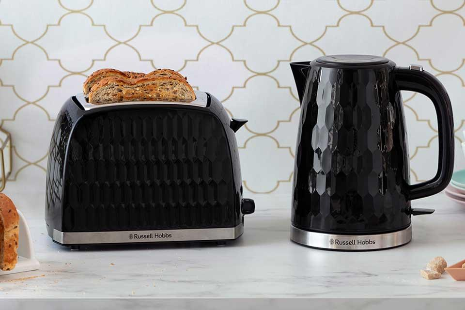 Russell Hobbs Honeycomb textured kettle and toaster on a kitchen counter.