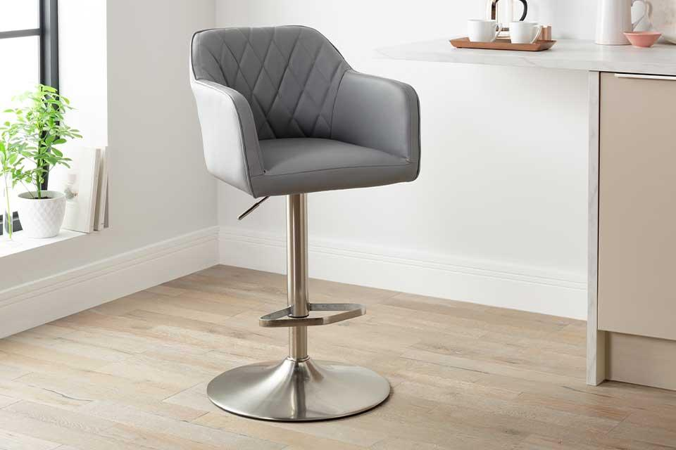 Argos Home Ellington quilted grey faux leather bar stool in front of a breakfast bar.