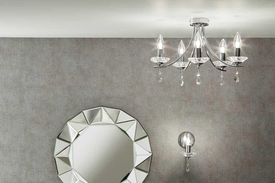 A bathroom with a 5 light semi flush chandelier in glass and chrome.