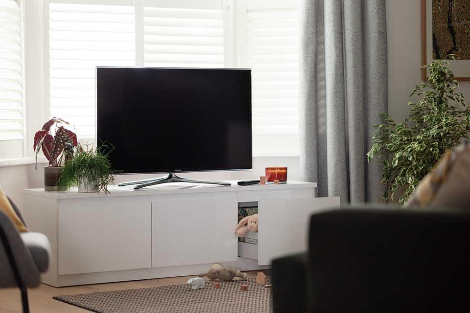 The Habitat Jenson 2 drawer TV unit in a lounge with a TV on top.