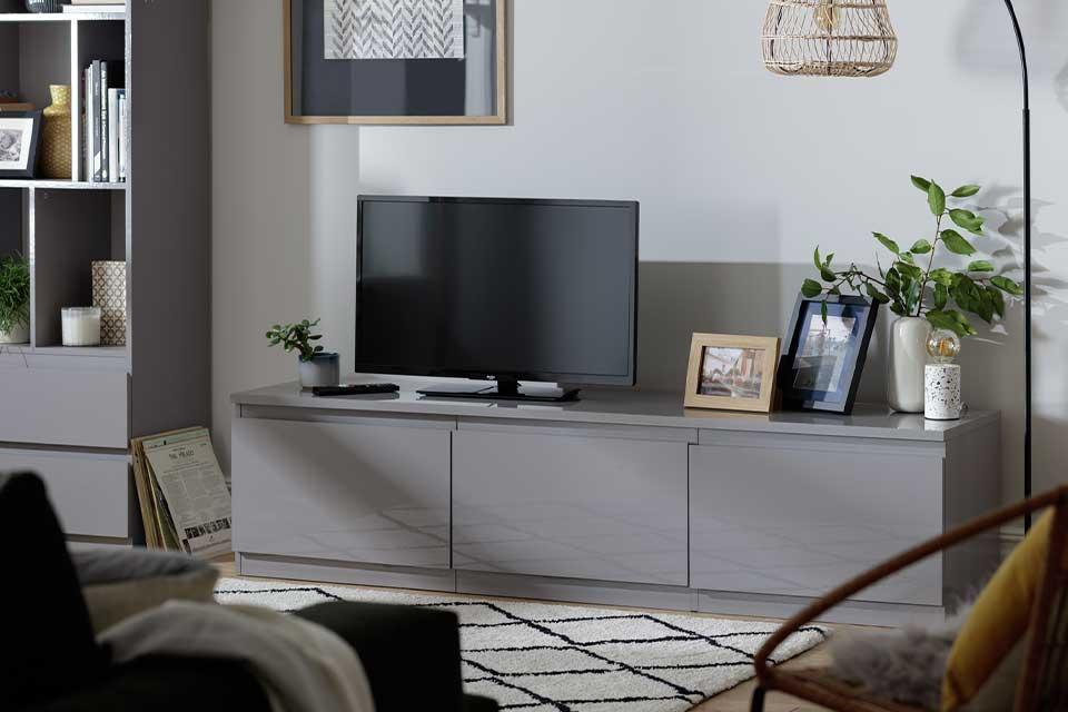The grey gloss handle-less Habitat Jenson TV unit with 3 cupboards in a lounge.